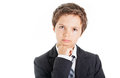 Thinking boy in white shirt tie and jacket looking at the camera having a thoughtful look Royalty Free Stock Photo