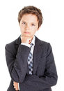 Thinking boy in white shirt tie and jacket looking at the camera having a thoughtful look Stock Photo