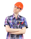 Thinking builder with orange helmet isolated on white Royalty Free Stock Images