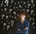 Thinking business man chalk questions marks blackboard background Royalty Free Stock Photo