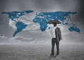 Thinking businessman viewing world map holding jacket and umbrella Royalty Free Stock Image