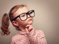 Thinking cute kid girl looking instagram effect portrait Royalty Free Stock Photo