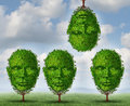 Thinking different creativity concept with a group of trees shaped as a human head with one tree upside down as a symbol freedom Royalty Free Stock Photo
