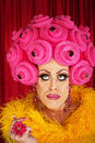Thinking drag queen serious man in with yellow boa and wig Stock Image