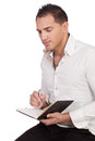Thinking man portrait of while holding a pen and notebook Stock Photo