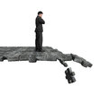 Thinking man standing on breaking puzzle ground Royalty Free Stock Photo