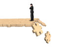 Thinking man standing on breaking puzzle path Royalty Free Stock Photo