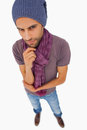 Thinking man wearing beanie hat and scarf on white background Royalty Free Stock Images