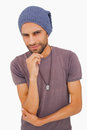 Thinking man wearing beanie hat on white background Stock Photos