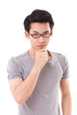 Thinking nerd man looking at you, white isolated Royalty Free Stock Photo