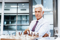 Thinking the next move businessman in office playing chess Royalty Free Stock Photos