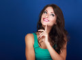 Thinking success happy beautiful brunette woman with finger unde Royalty Free Stock Photo