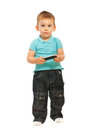 Thinking toddler holding cellphone Royalty Free Stock Photo