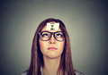Thinking woman with sand clock sticker on forehead. Time management concept Royalty Free Stock Photo