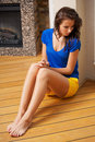 Thinking woman sitting on the floor Stock Photo