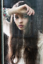 The thinking woman at window Royalty Free Stock Photo