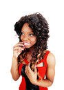 Thinking young woman a closeup picture of a jamaican standing with her finger on her mouth isolated on white background Stock Image