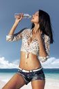 Thirst in hot day beautiful girl drinks water from bottle Royalty Free Stock Image