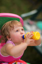 Thirsty baby girl Royalty Free Stock Photo