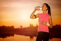 Thirsty female runner Royalty Free Stock Photo