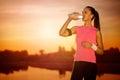 Thirsty female runner Royalty Free Stock Photo