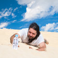 Thirsty man in the desert reaches for water a bottle of pure Royalty Free Stock Photo