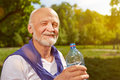 Thirsty senior man drinking water fresh after sports Royalty Free Stock Photos