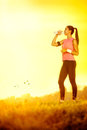 Thirsty sporty woman young on sunny day Royalty Free Stock Images