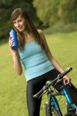 Thirsty woman on bike Royalty Free Stock Photo