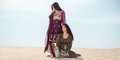 Thirsty women traveling in desert. Lost in desert durind sandshtorm Royalty Free Stock Photo