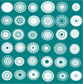 Thirty-six different white snowflakes, flowers and napkins on a bright green background