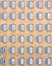 Thirty-six windows on vintage building Stock Images