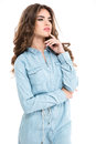 Thoughful attractive young woman with curly hair in jeans shirt Royalty Free Stock Photo