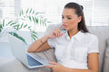 Thoughful woman looking at laptop Royalty Free Stock Photo