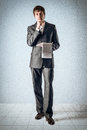 Thought business man with a notebook Stock Image