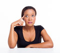 Thoughtful african american businesswoman looking up on white background Stock Photos