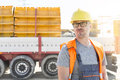 Thoughtful architect standing against truck at construction site Royalty Free Stock Photo