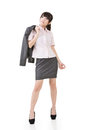 Thoughtful asian business woman full length portrait of wear skirt suit isolated on the white background Royalty Free Stock Images