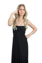 Thoughtful attractive blonde with black cocktail dress posing on white background Royalty Free Stock Photography