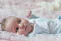 Thoughtful baby indoor in blue cloth Stock Images