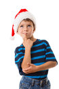 Thoughtful boy in santa hat thinking about choice isolated on white Royalty Free Stock Photos