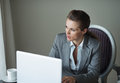 Thoughtful business woman in hotel room Royalty Free Stock Photo