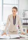 Thoughtful business woman in office Royalty Free Stock Photo