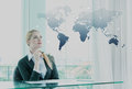 Thoughtful businesswoman in office, business globalization conce