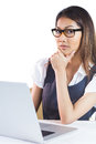 Thoughtful businesswoman using laptop and holding her chin on white background Royalty Free Stock Photos