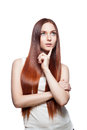 Thoughtful casual red-haired female on white Stock Image