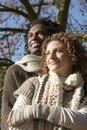Thoughtful couple looking away while embracing at park closeup of young Royalty Free Stock Images