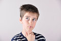 Thoughtful cute young boy looking up Royalty Free Stock Photo