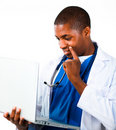 Thoughtful doctor working with a computer Royalty Free Stock Photo