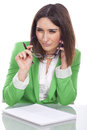 Thoughtful executive secretary holding glasses Royalty Free Stock Photography